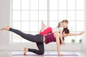 exercising at home with child